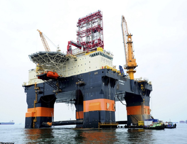Scarabeo 9, a new Chinese-built drilling rig, is seen in Singapore in this August 26, 2011 handout photo. The Scarabeo 9, owned by Italian oil giant Eni SpA's offshore unit Saipem and contracted in Cuba by Spanish oil firm Repsol YPF, was anchored in Singapore and ready to leave on what an Eni spokesman said would be an 80-day voyage. Picture taken August 26, 2011. REUTERS/Keppel Offshore & Marine/Handout (SINGAPORE - Tags: ENERGY BUSINESS COMMODITIES) FOR EDITORIAL USE ONLY. NOT FOR SALE FOR MARKETING OR ADVERTISING CAMPAIGNS. THIS IMAGE HAS BEEN SUPPLIED BY A THIRD PARTY. IT IS DISTRIBUTED, EXACTLY AS RECEIVED BY REUTERS, AS A SERVICE TO CLIENTS (Newscom TagID: rtrlfour755278) [Photo via Newscom]